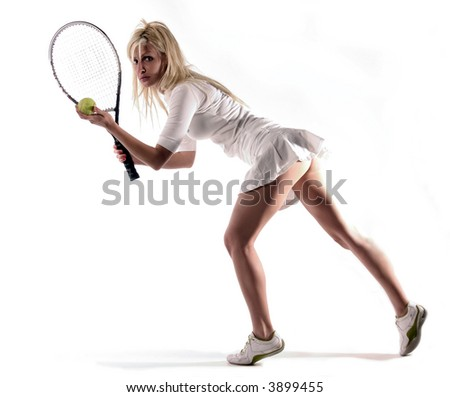 a girl is preparing to serve - stock photo