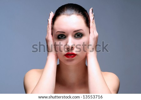 a girl is putting hands on her ears - stock photo