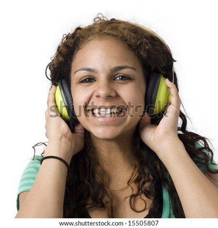 A girl listens to music with green headphones - stock photo