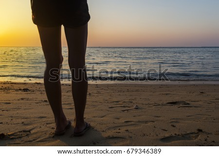 A girl looking sunset and sea in evening time.