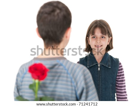 A girl meets a boy, which is going to present her a red rose, held in his hand; isolated on the white background - stock photo