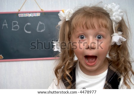A girl on a first lesson at school - stock photo