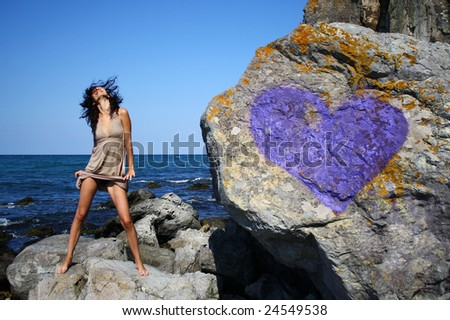A girl on some cliffs near the town of Sozopol - stock photo