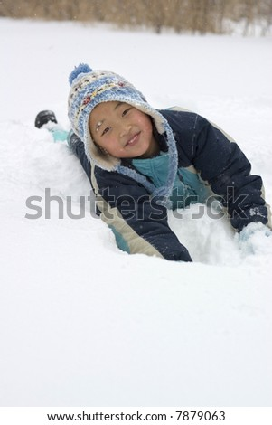 a girl playing in snow - stock photo
