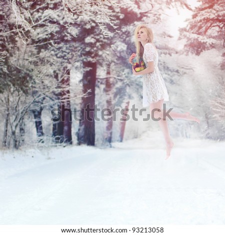 A girl posing in a winter forest. conceptual photo - stock photo
