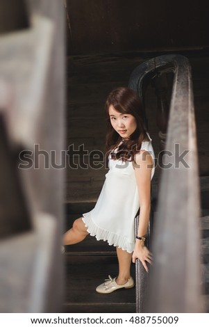 a girl Pretty Asian Chinese woman smiling ,Vintage style photo