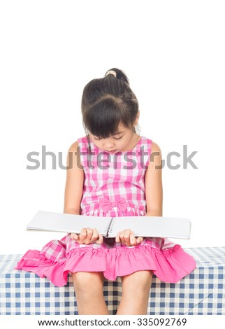 A girl reading a book, on the white background. - stock photo