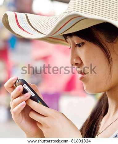 A girl  reading sms from a mobile when she is not happy - stock photo