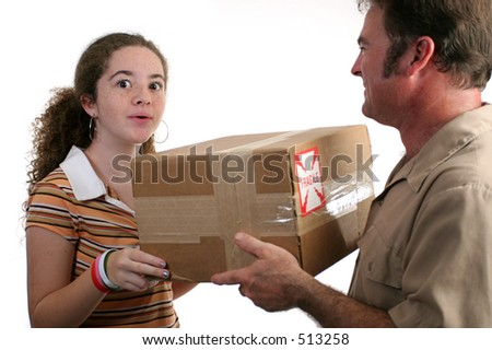 a girl receiving a package and looking surprised - isolated - stock photo