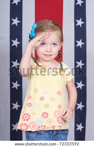 A girl saluting the viewer.  The viewer is taller then her, it could be a parent. - stock photo