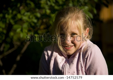 A girl scared outside in the evening. - stock photo