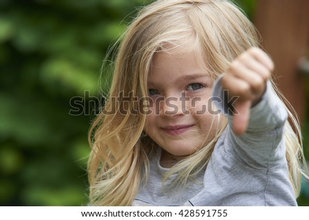 A girl showing the thumbs down