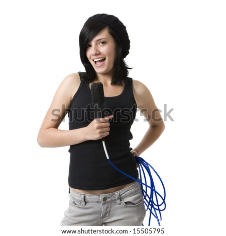 A girl sings into a mic - stock photo