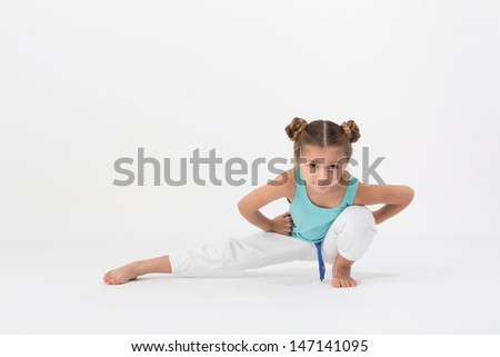 A girl sitting on one leg and make gymnastic exercise