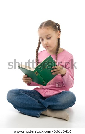 A girl sitting on the floor and reading a book