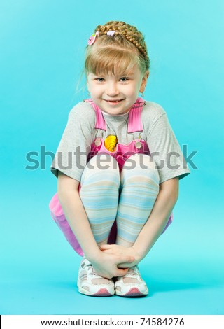 A girl sitting squatted - stock photo