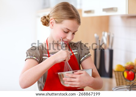 a girl standing in the kitchen  - stock photo