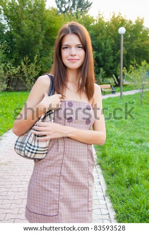 A girl walks in the park