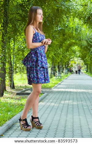 A girl walks in the park - stock photo