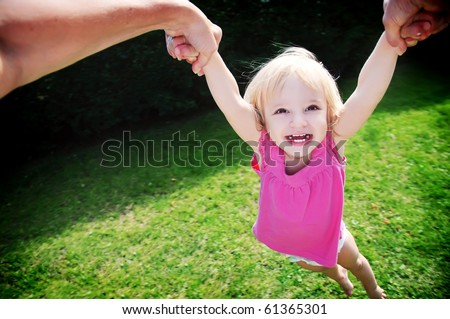 A girl who laughs and flies . - stock photo