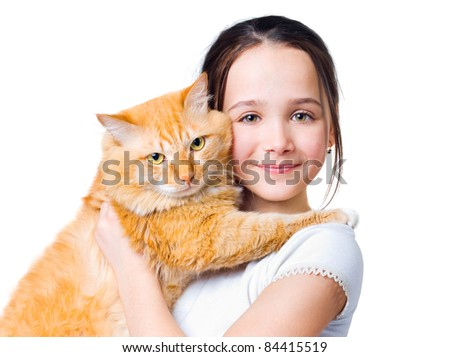 A girl with a big red cat in her arms - stock photo