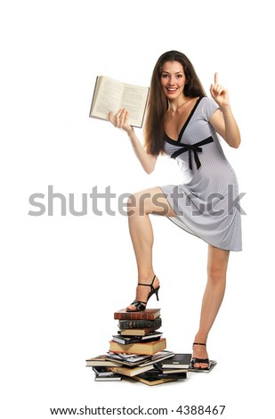 A girl with a book on the white background - stock photo