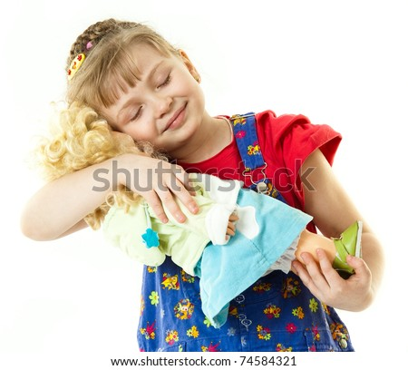 A girl with a doll - stock photo