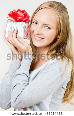 A girl with a gift in hand - stock photo