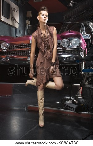 a girl with a grunge car - stock photo