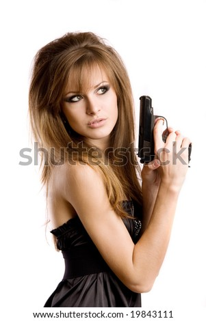 A girl with a gun - stock photo