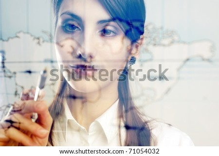 A girl with a map of the world printed on a transparent material - stock photo