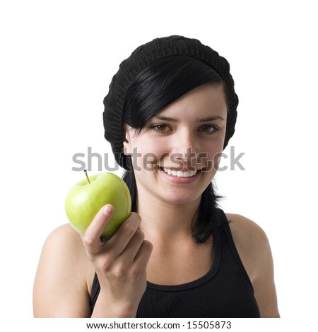 A girl with an apple smiles