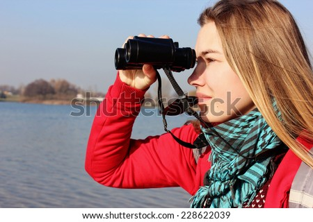 a Girl with binoculars, Woman traveler, Looking for, Journey path or Be free - stock photo