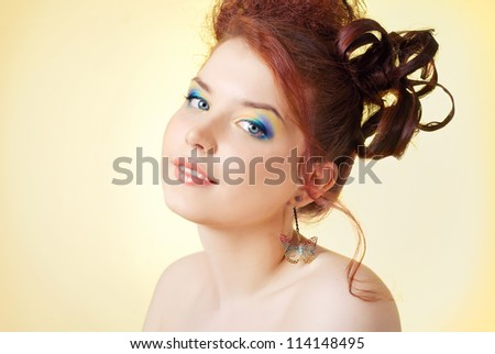 A girl with bright makeup on a yellow background - stock photo
