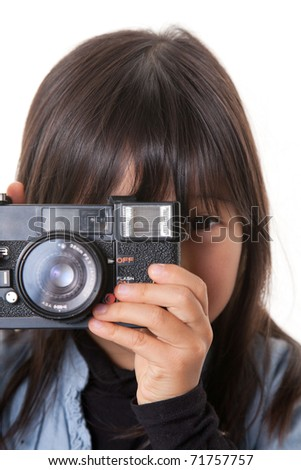a girl with camera taking photograph. - stock photo