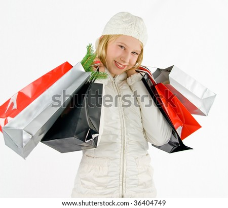 a girl with colored bags - stock photo