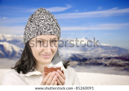 A girl with cup of tea on winter day