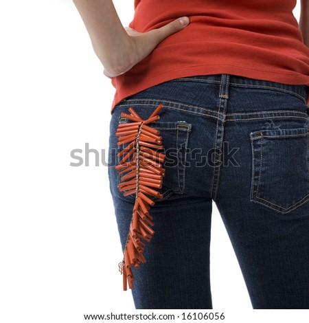 A girl with firecrackers in her back pocket