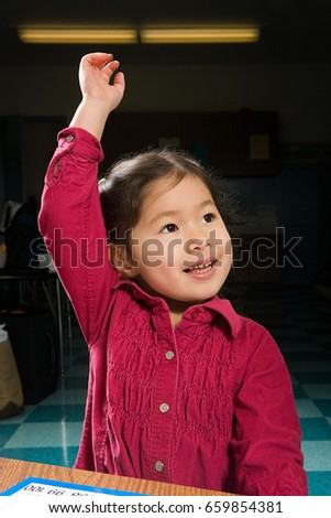 A girl with his arm raised