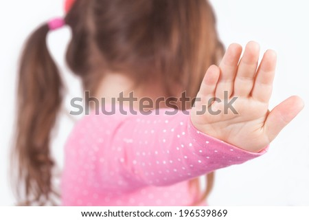 A girl with ponytail say talk to my hand. Background unsharp - stock photo