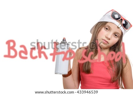 a girl writing back to school with a spray can, on white background - stock photo