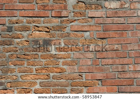 A girtty brick wall as a background. - stock photo