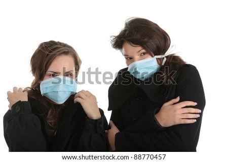 A glamorous model wearing a mask to prevent 'Swine Flu' infection. Isolated - stock photo
