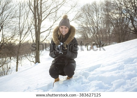 A glamorous winter portrait of a girl outside
