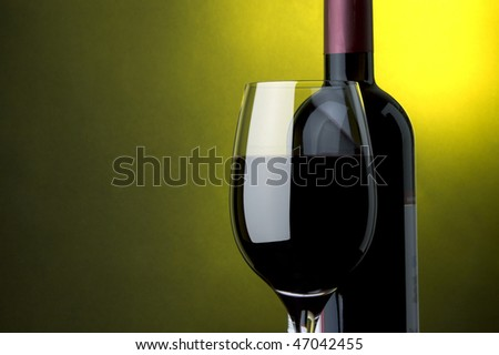 a glass and a bottle of red wine