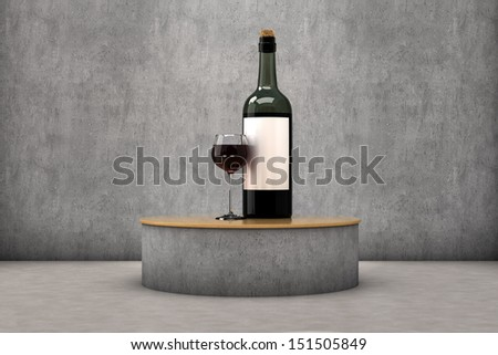 A glass and a bottle of wine in a exhibitor - stock photo