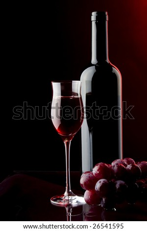 a glass bottle and grape