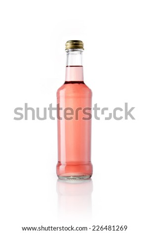 A glass bottle with red soft drink reflective bottom isolated white. - stock photo