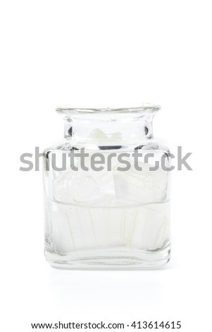 A glass bowl full of freshly picked Aloe vera plant, peeled and cut into pieces isolated on white, Fresh Aloe Vera is natural remedy for sunburn relief and cure many things.