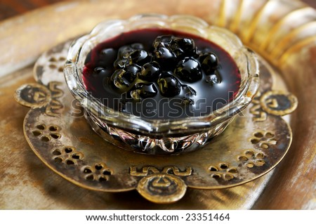 A glass bowl of blueberry jam